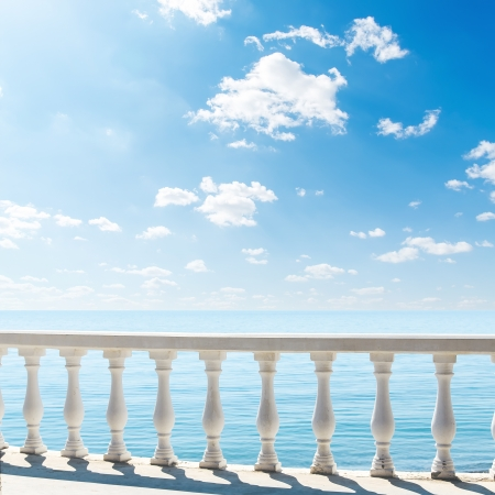 balustrade: clouds over sea  view from terrace with balcony
