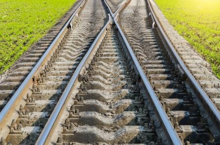 rail cross: two railroad to horizon Stock Photo