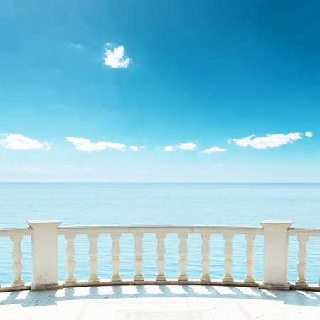 balcony near sea under deep blue sky photo