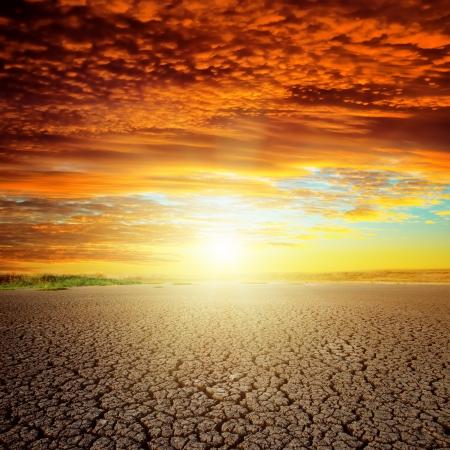 desert sunset: good red sunset over drought eart