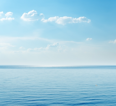 ocean: blue sea and clouds on sky