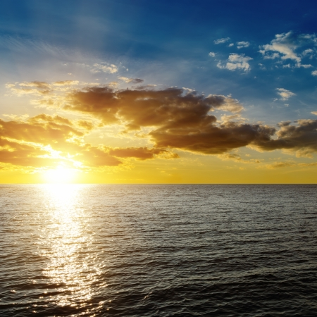 horizon over water: sunset over dark sea Stock Photo
