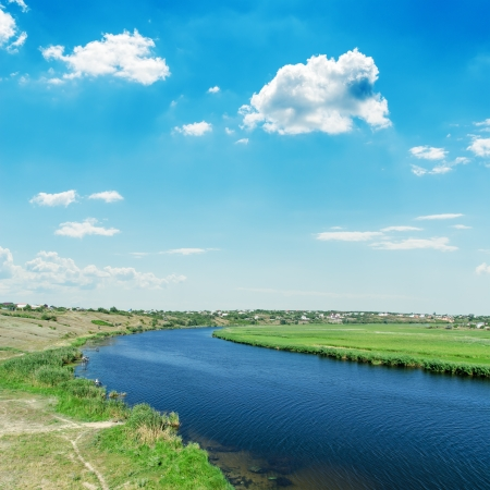 river and blue sky with clouds photo