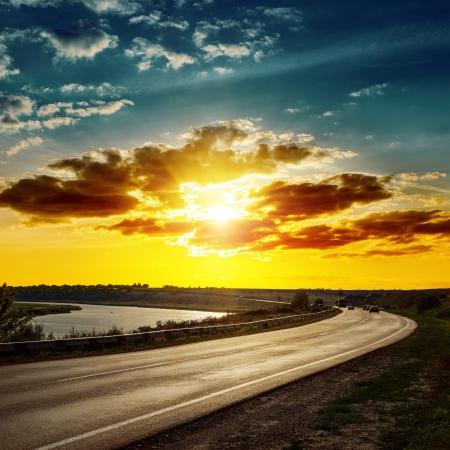 horizon over land: good sunset over asphalt road