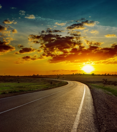 beautiful sunset over asphalt road Stock Photo