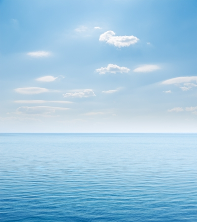 sea line: blue sea and cloudy sky over it