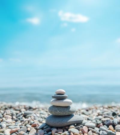 zen like: heap of stones like zen near sea. soft focus Stock Photo