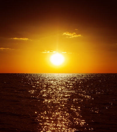 horizon over water: golden sunset over dark water