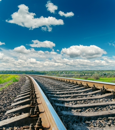 railtrack: railroad closeup to horizon and deep blue sky with clouds