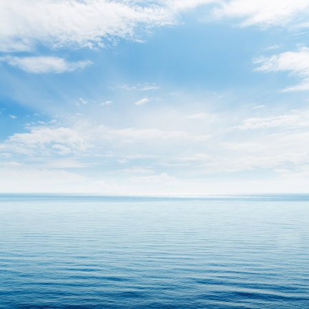 deep blue: blue sea and clouds in sky