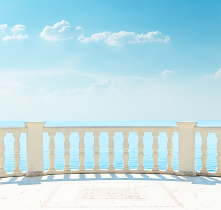 balcony near sea under cloudy sky photo