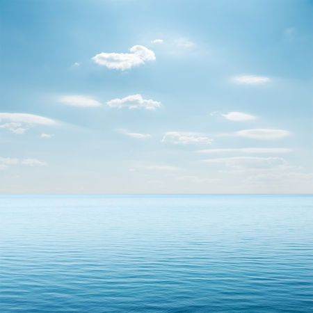 calm background: clouds over blue sea