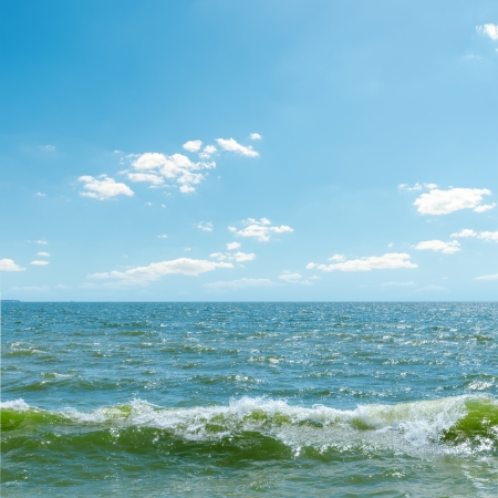 horizon over water: blue sky over sea with waves Stock Photo