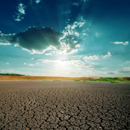 arid climate: global warming. dramatic sky over cracked earth