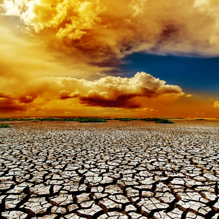dramatic color clouds over drought earth