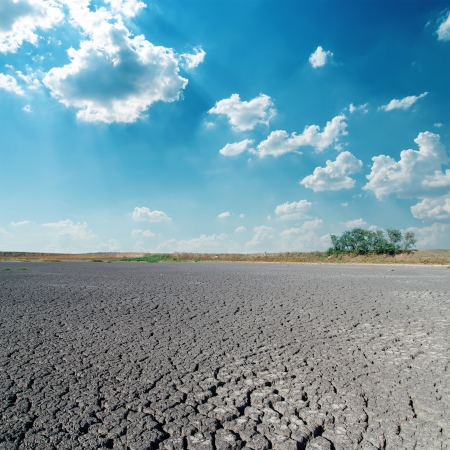 arid climate: desert and clouds in blue sky Stock Photo