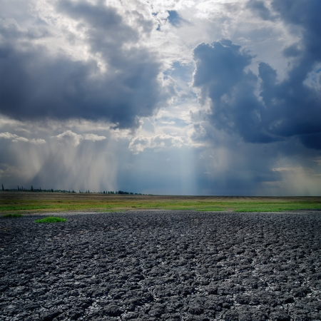 drought land and dramatic sky with clouds Stock Photo