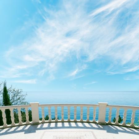 hotel balcony: balcony over sea and cloudy sky Stock Photo
