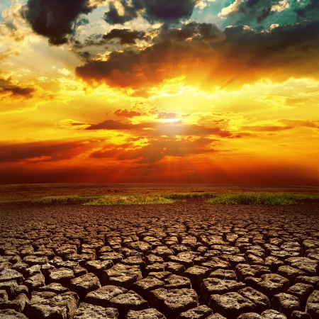 割れた地球の幻想的な夕日 写真素材