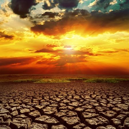 fantastic sunset over cracked earth Standard-Bild