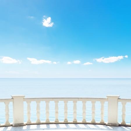 hotel balcony: white balcony on terrace near sea and blue sky