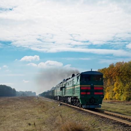 railtrack: old train and smoke over it Stock Photo