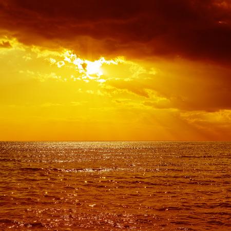over the sea: dramatic orange sunset over sea Stock Photo