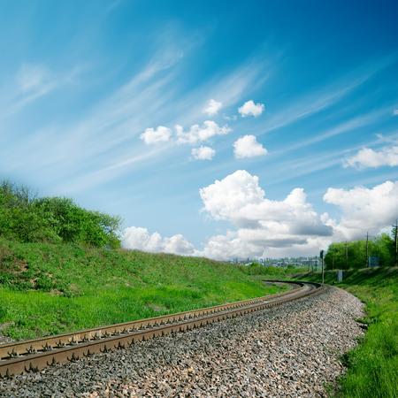 railroad to horizon and cloudy sky photo