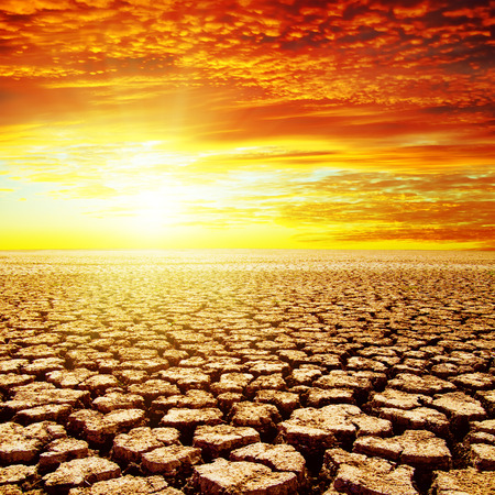 red sunset over drought earth