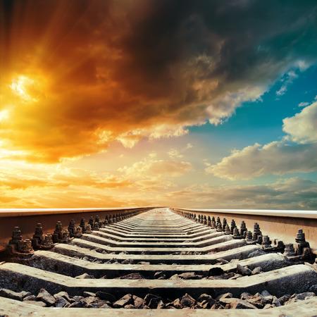 railway closeup to horizon under colored sky in sunset photo