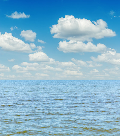 horizon over water: white clouds in sky over blue sea