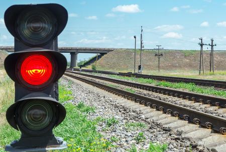 rail cross: red semaphore near railroad