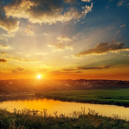 evening glow: dramatic orange sunset over river