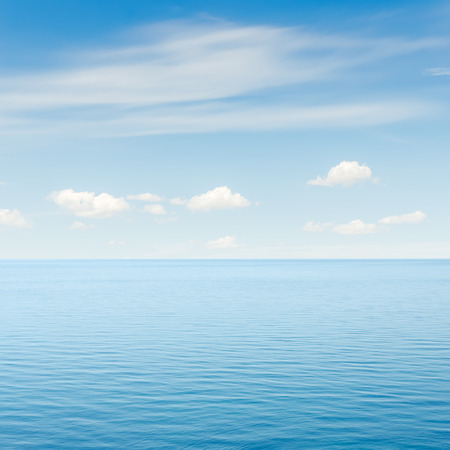 deep ocean: blue sea and sky with clouds over it Stock Photo