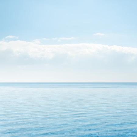 light cloud over blue sea photo