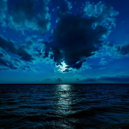 moon light over dark water photo
