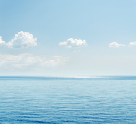 sea view: blue sea and clouds over it