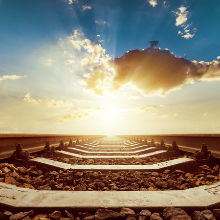 sunset with clouds over railroad close up 스톡 콘텐츠