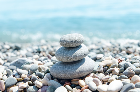 stone heap: three stones on stack near sea. zen like concept