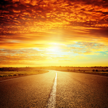 country roads: good red sunset and asphalt road to horizon
