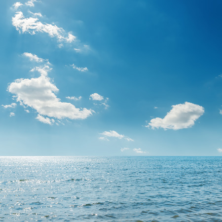 clouds in blue sky over sea photo