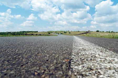 white line on asphalt road closeup. soft focus Stock Photo