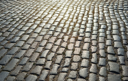 cobblestone street: cobbled road as background on sunset