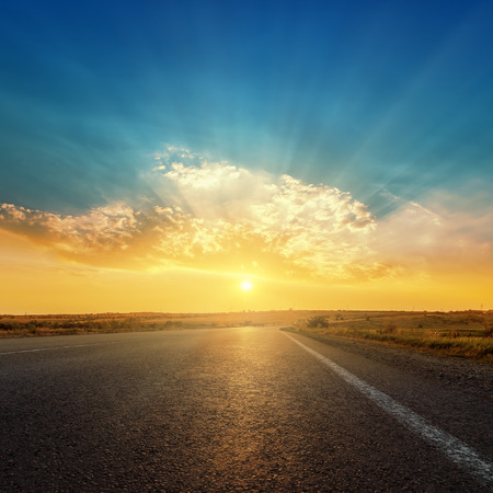 asphalt road and sunset in clouds 스톡 콘텐츠