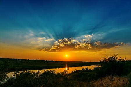 blue water background: fantastic sunset over river