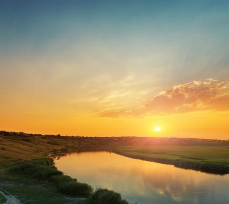 orange sunset: orange sunset with clouds over river