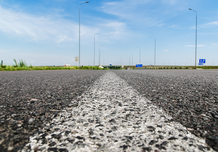 solid line: solid white line on asphalt road closeup. soft focus
