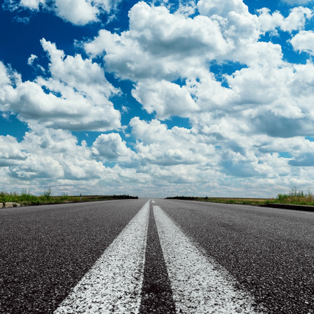 over white: dramatic sky over asphalt road with two white line Stock Photo