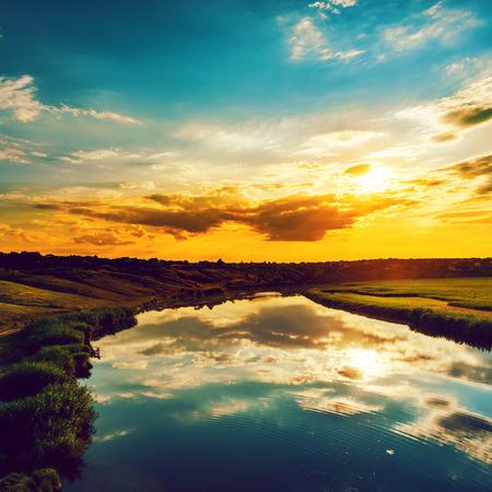 orange sunset: good sunset over river