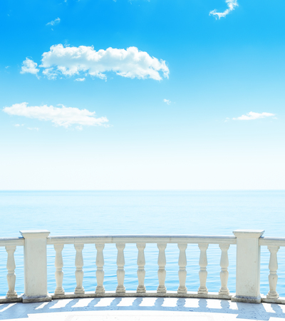 view on sea: balcony near sea and blue sky with clouds